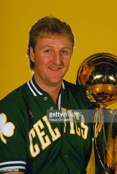 Larry Bird of the Boston Celtics poses with the Larry O'Brien Trophy circa 1984 at The Boston Garden in Boston Massachusetts