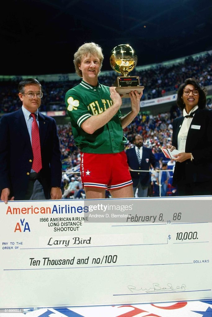 Larry Bird of the Boston Celtics poses with the trophy and a check after winning the three point shootout during NBA AllStar weekend on February 8...