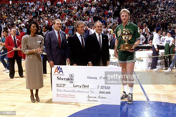 Larry Bird of the Boston Celtics receives the Trophy for winning the Long Distance shootout contest during the February 1987 NBA All Star Weekend in...