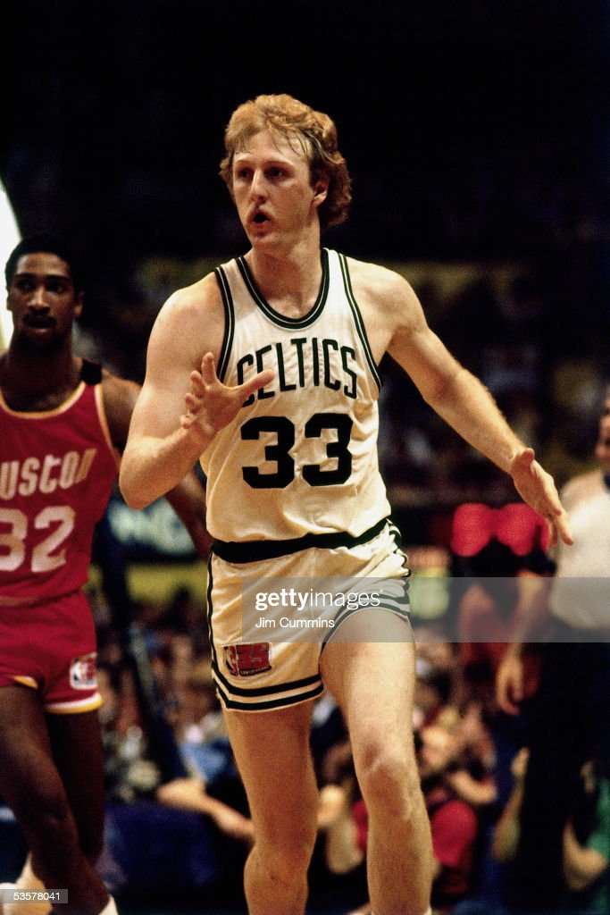 Larry Bird of the Boston Celtics runs a play against the Houston Rockets during an NBA game circa 1980 at the Boston Garden in Boston Massachussetts...