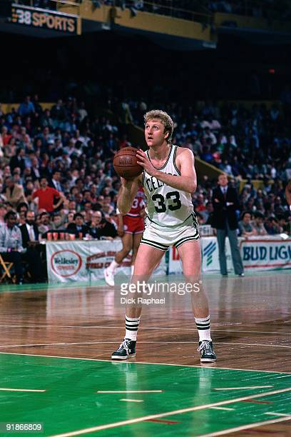 Larry Bird of the Boston Celtics shoots a free throw during a game played in 1986 at the Boston Garden in Boston Massachusetts NOTE TO USER User...