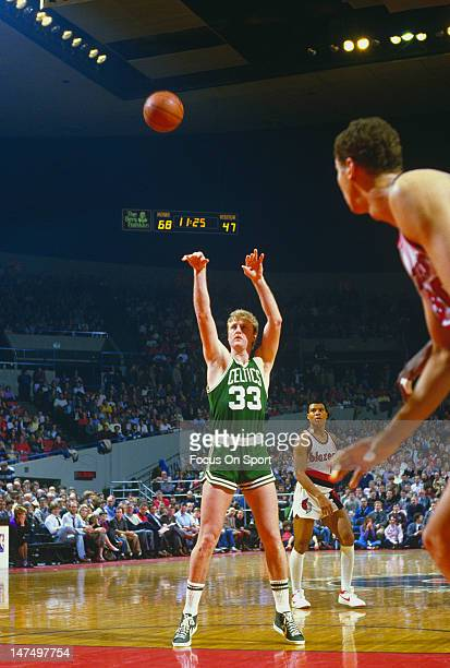 Larry Bird of the Boston Celtics shoots a freethrow against the Portland Trailblazers during an NBA basketball game circa 1983 at the Memorial...