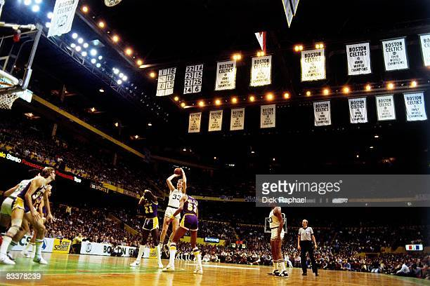 Larry Bird of the Boston Celtics shoots a jump shot against Jamaal Wilkes of the Los Angeles Lakers during a game played circa 1982 at the Boston...
