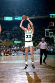 Larry Bird of the Boston Celtics shoots a jump shot circa 1986 at the Boston Garden in Boston Massachusetts NOTE TO USER User expressly acknowledges...