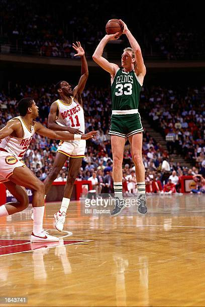 Larry Bird of the Boston Celtics shoots a jump shot during a 1990 NBA game against Vernon Maxwell of the Houston Rockets at the Summit in Houston...