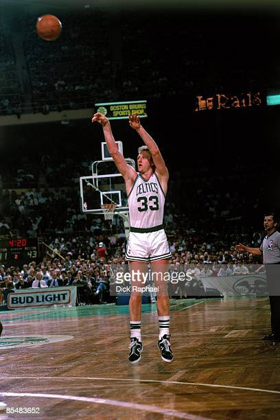 Larry Bird of the Boston Celtics shoots a jump shot during a game played in 1987 at the Boston Garden in Boston Massachusetts NOTE TO USER User...