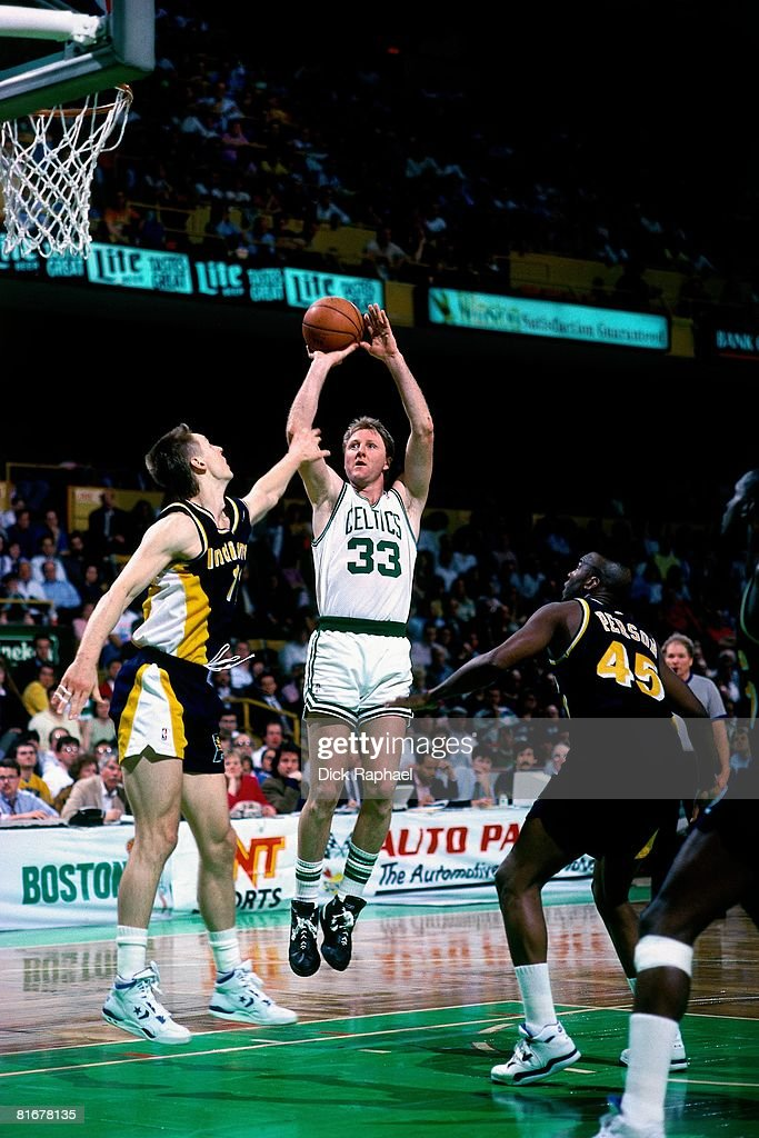 Larry Bird of the Boston Celtics shoots a jump shot over Detlef Schrempf of the Indiana Pacers circa 1991 at the Boston Garden in Boston...