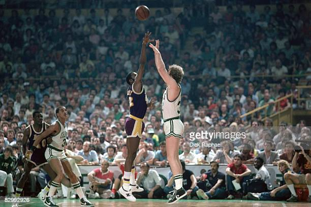 Larry Bird of the Boston Celtics shoots a jump shot over James Worthy of the Los Angeles Lakers in Game Five of the 1984 NBA Finals played on June 8...