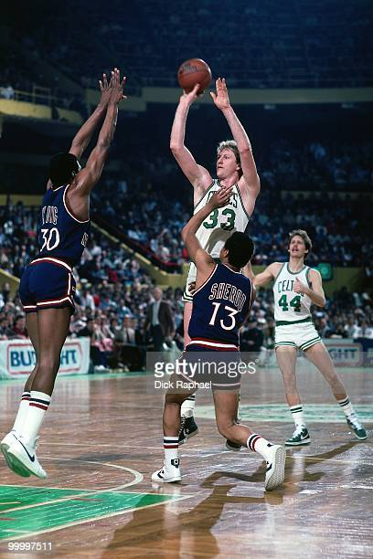 Larry Bird of the Boston Celtics shoots a jumper against Bernard King of the New York Knicks during a game played in 1983 at the Boston Garden in...