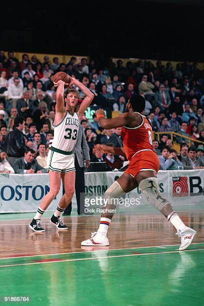 Larry Bird of the Boston Celtics shoots a jumper against the Cleveland Cavaliers during a game played in 1986 at the Boston Garden in Boston...