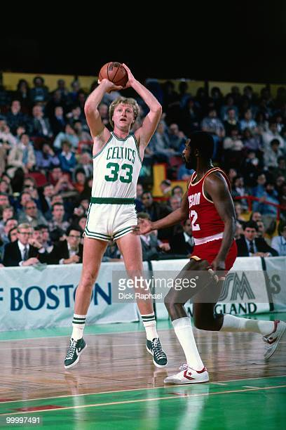 Larry Bird of the Boston Celtics shoots a jumper against the Houston Rockets during a game played in 1983 at the Boston Garden in Boston...