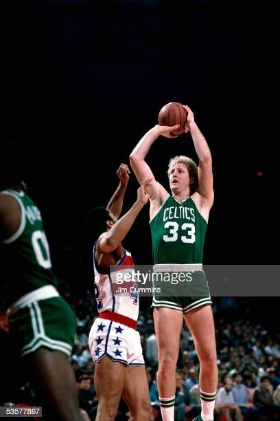 Larry Bird of the Boston Celtics shoots a jumpshot against the Baltimore Bullets during an NBA game circa 1984 at the Capital Centre in Baltimore...