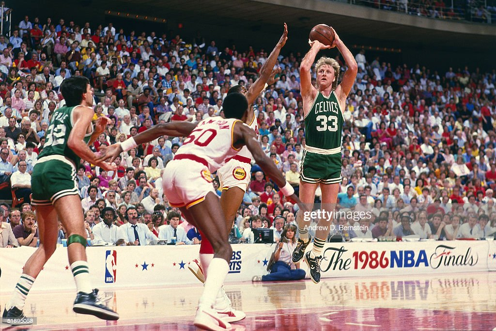 Larry Bird of the Boston Celtics shoots a jumpshot over a Houston Rockets defender during the 1986 NBA Finals at the Summit on June 1 1986 in Houston...