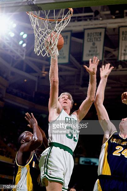 Larry Bird of the Boston Celtics shoots a layup against Greg Dreiling of the Indiana Pacers during a game circa 1992 at Boston Garden in Boston...