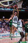 Larry Bird of the Boston Celtics shoots a layup against the Milwaukee Bucks during a game played in 1988 at the Boston Garden in Boston Massachusetts...