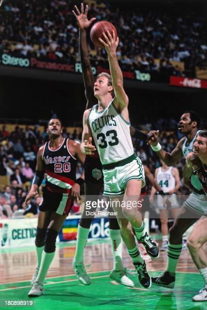 Larry Bird of the Boston Celtics shoots a layup during a game against the Portland Trail Blazers circa 1986 at the Boston Garden in Boston...