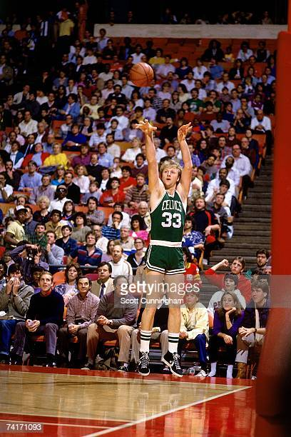 Larry Bird of the Boston Celtics shoots a three pointer from the corner during a 1985 NBA game NOTE TO USER User expressly acknowledges that by...