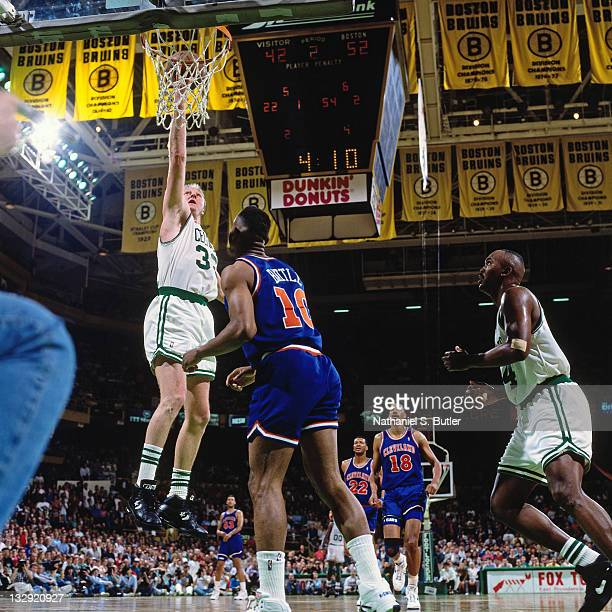 Larry Bird of the Boston Celtics shoots against John Battle of the Cleveland Cavaliers at the Boston Garden in Boston Massachusetts circa 1991 NOTE...