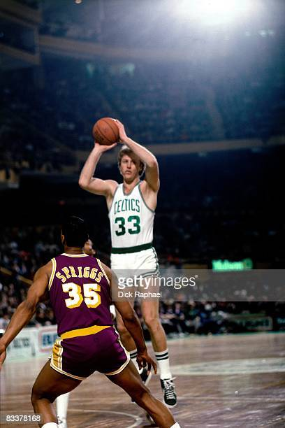 Larry Bird of the Boston Celtics shoots against Larry Spriggs of the Los Angeles Lakers during a game played circa 1985 at the Boston Garden in...