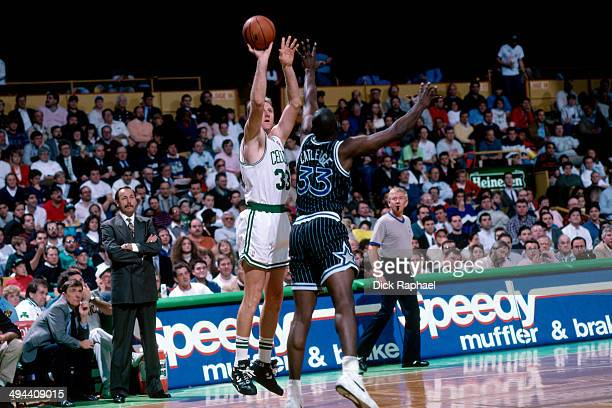 Larry Bird of the Boston Celtics shoots against Terry Catledge of the Orlando Magic during a game played in 1992 at the Boston Garden in Boston...