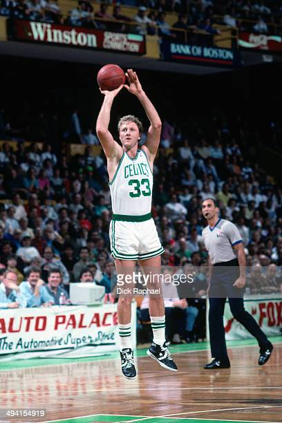 Larry Bird of the Boston Celtics shoots against the Chicago Bulls during a game played circa 1990 at the Boston Garden in Boston Massachusetts NOTE...