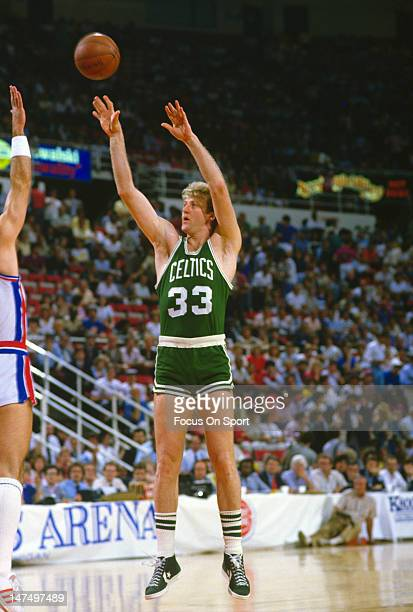 Larry Bird of the Boston Celtics shoots against the Detroit Pistons during an NBA basketball game circa 1985 at the Pontiac Silverdome in Pontiac...