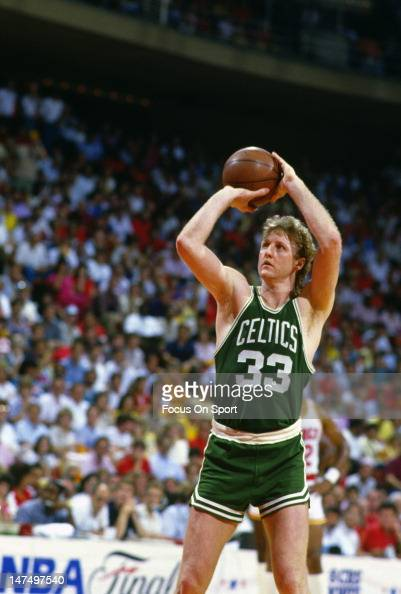 Larry Bird of the Boston Celtics shoots against the Houston Rockets during an NBA Finals June 1986 at The Summit in Houston Texas Bird played for the...