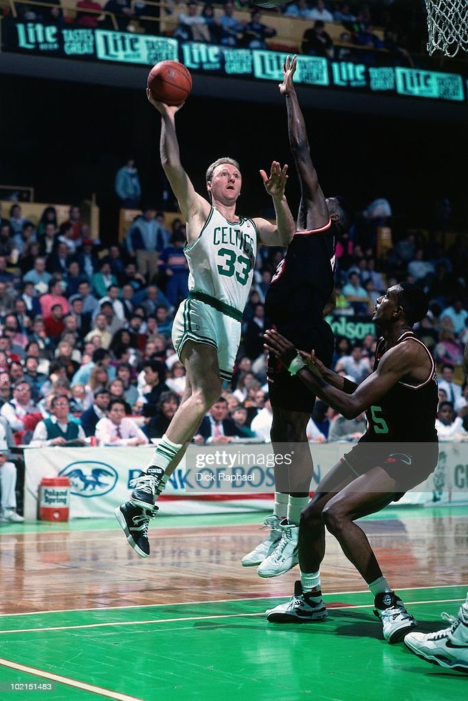 Larry Bird #33 of the Boston Celtics shoots against the Miami Heat during a game played in 1990 at the Boston Garden in Boston, Massachusetts.