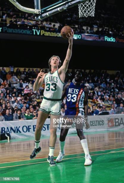 Larry Bird of the Boston Celtics shoots against the New Jersey Nets during a game played circa 1984 at the Boston Garden in Boston Massachussets NOTE...