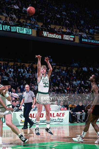 Larry Bird of the Boston Celtics shoots against the Portland Trail Blazers during a game played circa 1990 at the Boston Garden in Boston...