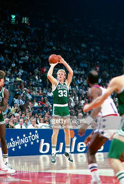 Larry Bird of the Boston Celtics shoots against the Washington Bullets during an NBA basketball game circa 1985 at the Capital Center in Landover...