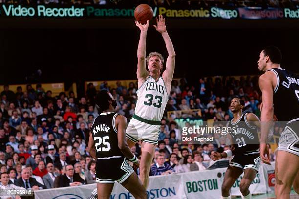 Larry Bird of the Boston Celtics shoots during a game against the San Antonio Spurs circa 1985 at the Boston Garden in Boston Massachusetts NOTE TO...