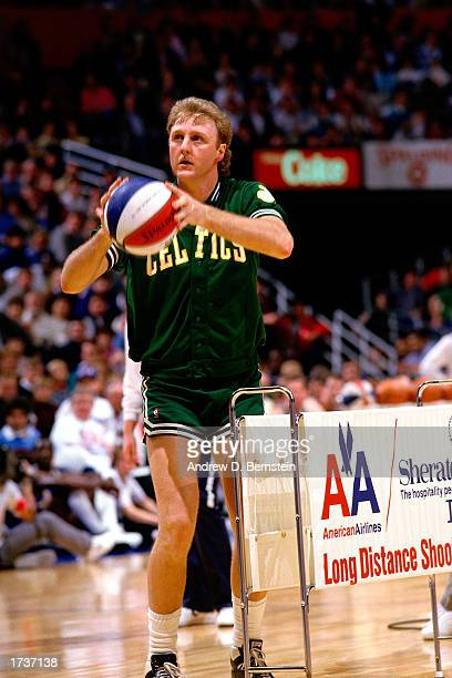 Larry Bird of the Boston Celtics shoots during the Long Distance shootout during the 1986 NBA All Star Weekend in Dallas Texas NOTE TO USER User...