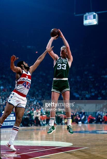 Larry Bird of the Boston Celtics shoots over Greg Ballard of the Washington Bullets during an NBA basketball game circa 1985 at the Capital Center in...