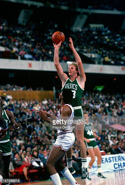 Larry Bird of the Boston Celtics shoots over Julius Erving of the Philadelphia 76ers during an NBA basketball game circa 1983 at the Spectrum in...