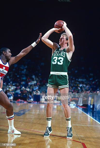 Larry Bird of the Boston Celtics shoots over Rick Mahorn of the Washington Bullets during an NBA basketball game circa 1983 at the Capital Center in...