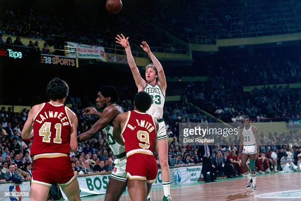 Larry Bird of the Boston Celtics shoots over the Cleveland Cavaliers during a game played in 1981 at the Boston Garden in Boston Massachusetts NOTE...