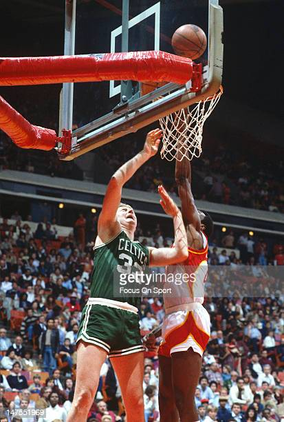 Larry Bird of the Boston Celtics shoots over Tree Rollins of the Atlanta Hawks during an NBA basketball game circa 1983 at the Omni Coliseum in...