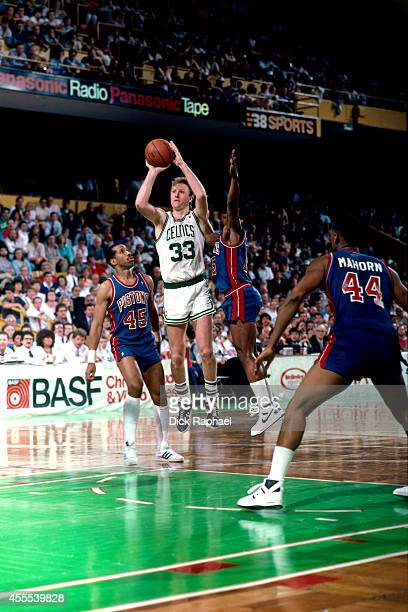 Larry Bird of the Boston Celtics shoots the ball against Adrian Dantley of the Detroit Pistons during a game circa 1987 at the Boston Garden in...