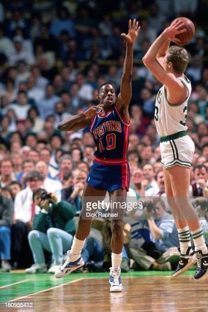 Larry Bird of the Boston Celtics shoots the ball against Dennis Rodman of the Detroit Pistons during a game circa 1988 at the Boston Garden in Boston...