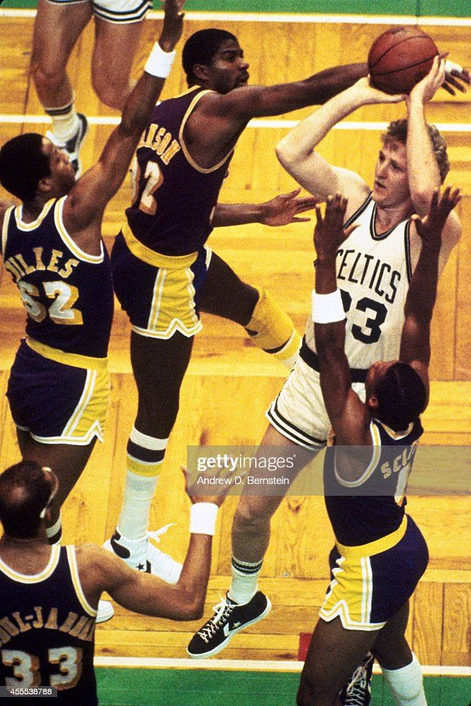 Larry Bird of the Boston Celtics shoots the ball during a game against Magic Johnson of the Los Angeles Lakers in 1984 at the Boston Garden in Boston...