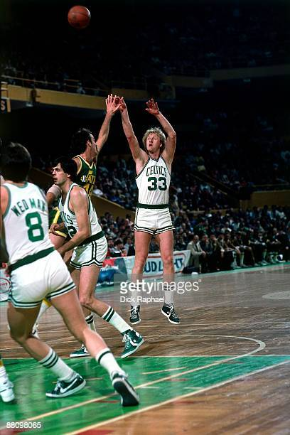 Larry Bird of the Boston Celtics shoots the jumper over Rich Kelley of the Utah Jazz during a game played in 1984 at the Boston Garden in Boston...