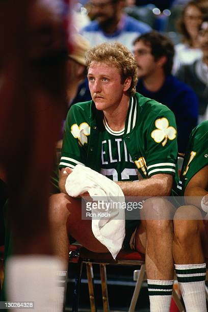 Larry Bird of the Boston Celtics sits on the bench against the Los Angeles Lakers during a game played circa 1987 at the LA Sports Arena in Los...