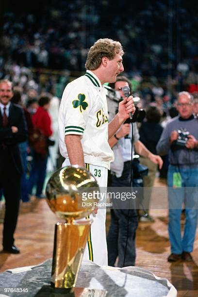 Larry Bird of the Boston Celtics speaks to the crowd during the 1984 NBA Championship Ring Ceremony prior to a game played against the New Jersey...