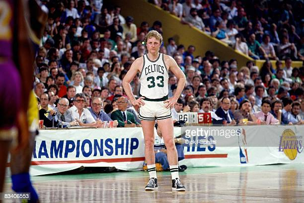 Larry Bird of the Boston Celtics stands on the court during Game Six of the 1985 NBA Finals against against the Los Angeles Lakers at the Boston...