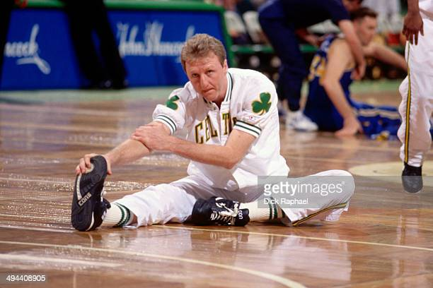 Larry Bird of the Boston Celtics stretches before a game played in 1992 at the Boston Garden in Boston Massachusetts NOTE TO USER User expressly...