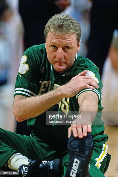 Larry Bird of the Boston Celtics stretches prior to a game during the 1991 NBA Playoffs at the Boston Garden in Boston Massachusetts circa 1991 NOTE...