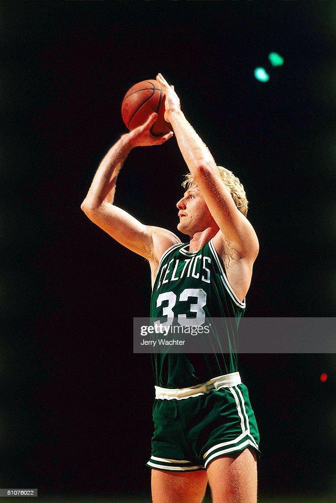 Larry Bird of the Boston Celtics takes a jump shot circa 1981 during an NBA game NOTE TO USER User expressly acknowledges and agrees that by...