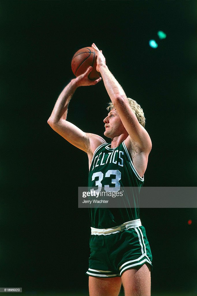 Larry Bird of the Boston Celtics takes a jumper during an NBA game NOTE TO USER User expressly acknowledges and agrees that by downloading and or...