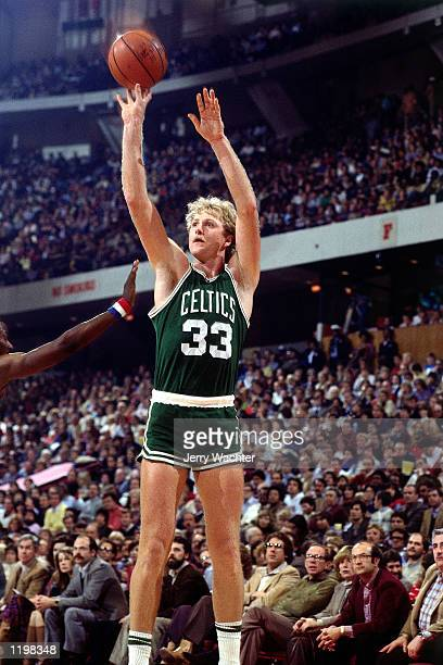 Larry Bird of the Boston Celtics takes a jumpshot during an NBA game NOTE TO USER User expressly acknowledges and agrees that by downloading and or...
